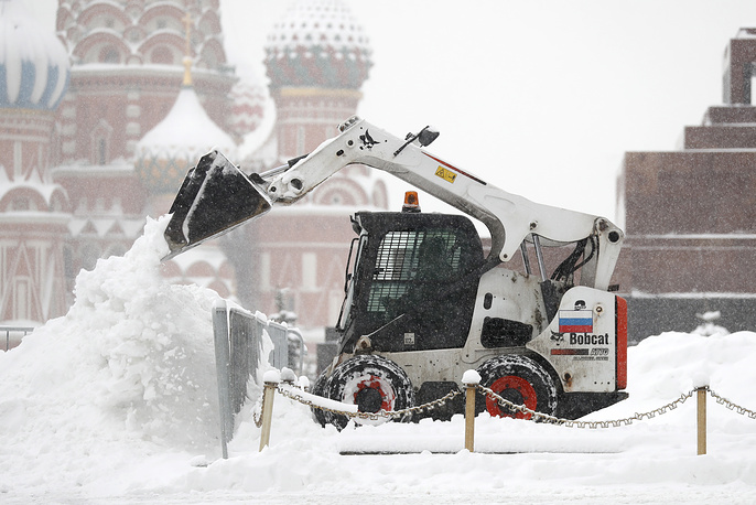 Clearing Moscow's Red Square after a heavy snowfall