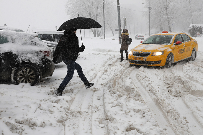 A taxicab making its way during a snowfall in Moscow