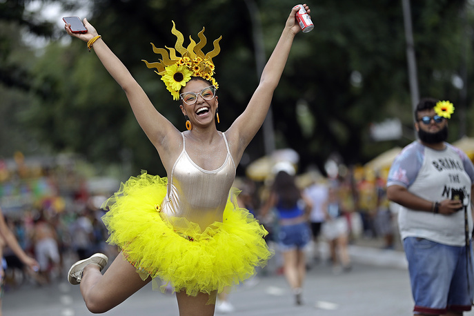 Woman in costume strikes a pose during the Bicho Maluco Beleza carnival parade in Sao Paulo