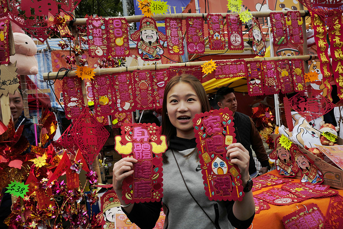 A vendor displays Chinese New Year decorations at a market in Victoria Park, Hong Kong