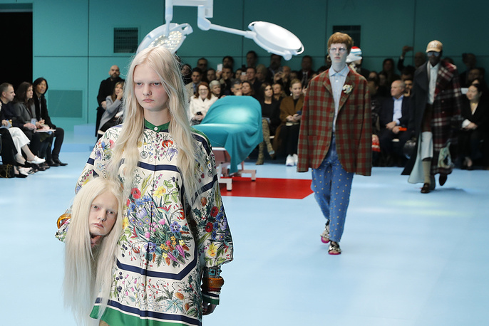 Models present creations by Italian label Gucci during the Milan Fashion Week, in Milan, Italy, February 21