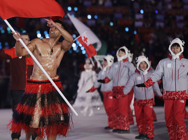 Pita Taufatofua carries the flag of Tonga during the opening ceremony of the 2018 Winter Olympics