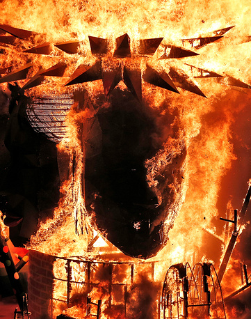 A 'Ninot' or wooden sculpture is burned during Las Fallas in Valencia