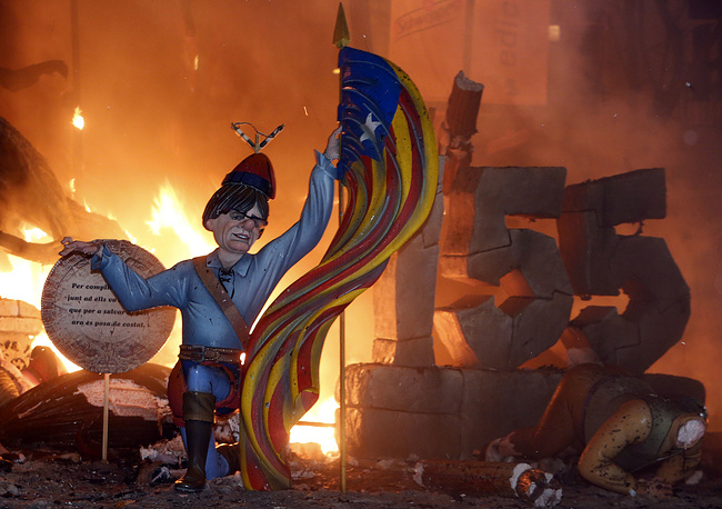 A figure representing Catalan's fugitive ex-president Carles Puigdemont burns during the last night of the Fallas Festival in Valencia