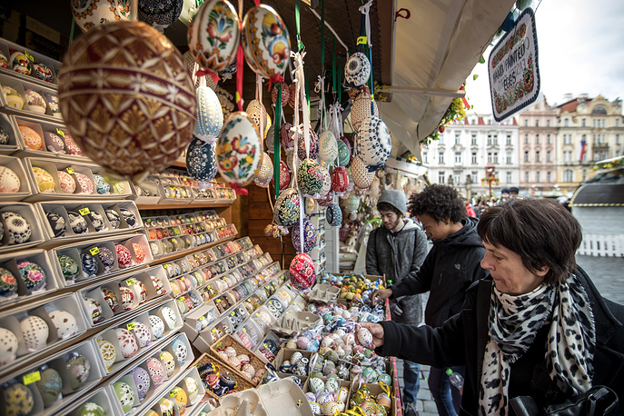Visitors look for Easter eggs at the traditional Easter market at the Old Town Square in Prague, Czech Republic