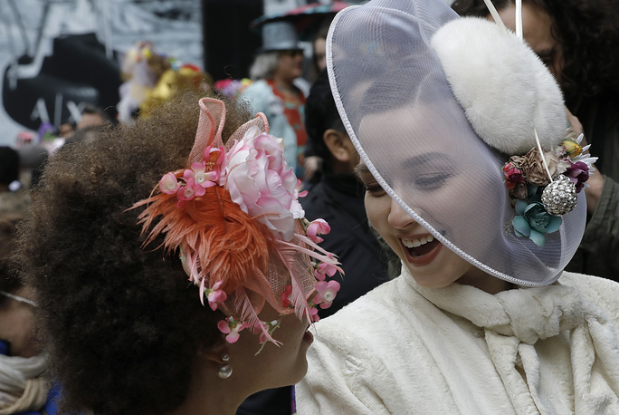 Women wear Easter bonnets at the Easter Bonnet Parade outside St. Patrick's Cathedral in New York City