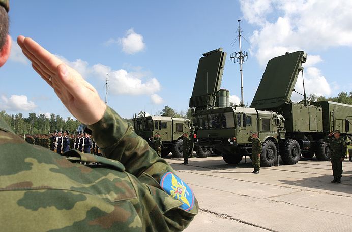 Soldier salutes near an S-400 Triumph missile system deployed at a military unit in the town of Elektrostal, Moscow region