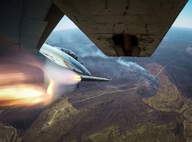 A Sukhoi Su-35S jet fighter launches free-flight missiles to hit ground targets at a firing range as part of the district stage of the 2018 Aviadarts military aviation competition, Primorye territory, Russia, April 4