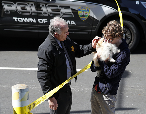 Chief of Burlingame Police reunites an unidentified YouTube employee with his dog after it was left at the scene following a shooting at the YouTube headquarters in San Bruno, California, USA, April 3