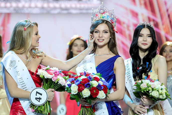 First Vice Miss Russia 2018 Violetta Tyurkina, Miss Russia 2018 Yulia Polyachikhina, and Second Vice Miss Russia 2018 Natalia Stroyeva in the final show of the 2018 Miss Russia National Beauty Contest at the Barvikha Luxury Village concert hall near Moscow, April 15