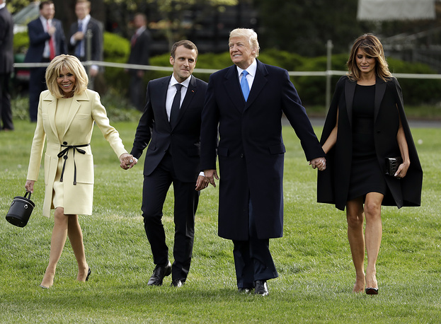 US President Donald Trump and First Lady Melania Trump walk on the South Lawn with French President Emmanuel Macron and his wife Brigitte Macron at the White House, in Washington DC, April 23