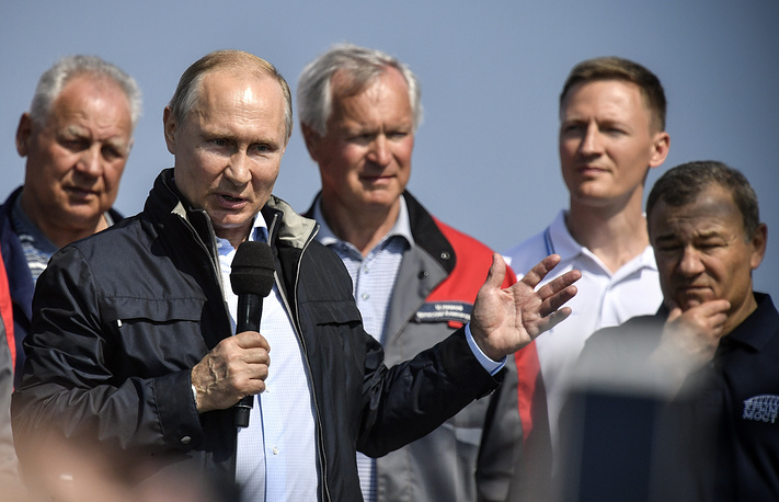 Russian President Vladimir Putin speaks to a group of workers after driving a truck to officially open the Kerch Strait (Crimean) Bridge