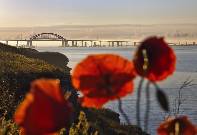The newly-opened Crimean Bridge seen in the distance, spanning 19 kilometers, links the Kerch Peninsula to mainland Russia, May 15