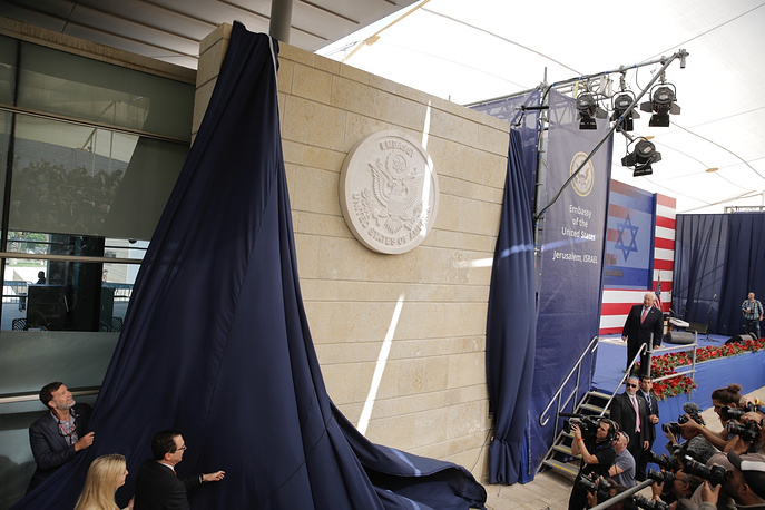 US President Donald Trump's daughter Ivanka Trump and US Treasury Secretary Steve Mnuchin unveil an inauguration plaque during the opening ceremony of the new US embassy in Jerusalem, May 14