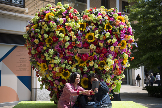 People photograph floral designs as part of the Chelsea in Bloom festival in Chelsea in London. Chelsea in Bloom is a festival running from May 21 to May 26 May alongside the RHS Chelsea Flower Show