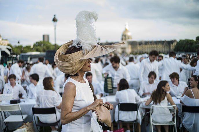 Thousands don themselves in white attire and share a dinner by the Invalides during the 30th edition of the 'Diner en Blanc' in Paris, June 3