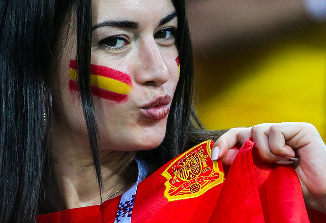 Spain's football fan with a Spanish national flag painted on her face at Fisht Stadium in Sochi