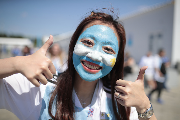 Supporter of the Argentine football team shows thumbs up outside Spartak metro station ahead of the 2018 FIFA World Cup Group D match between Argentina and Iceland in Moscow