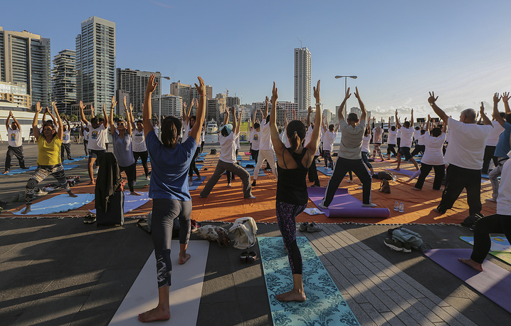 People practice practice yoga on the eve of 'International Day of Yoga' in Beirut, Lebanon