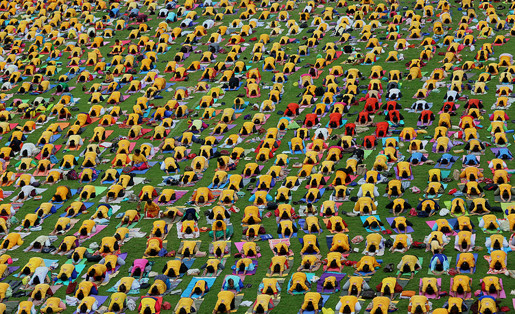 A general view showing hundreds of people performing yoga during 4th International Day of Yoga in Bangalore, India