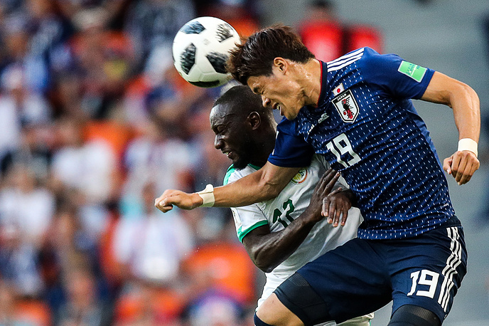 Senegal's Youssouf Sabaly and Japan's Hiroki Sakai jump to head the ball in group H match at Yekaterinburg Arena