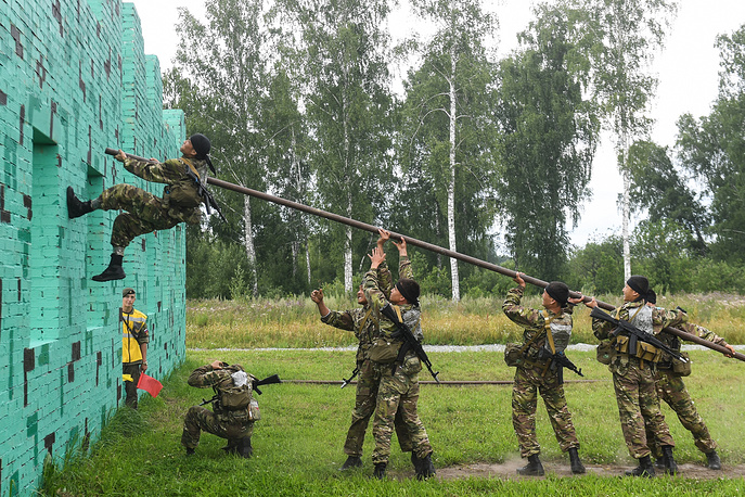 Servicemen of the Armed Forces of the Republic of Kazakhstan seen during the Scout Trail obstacle course