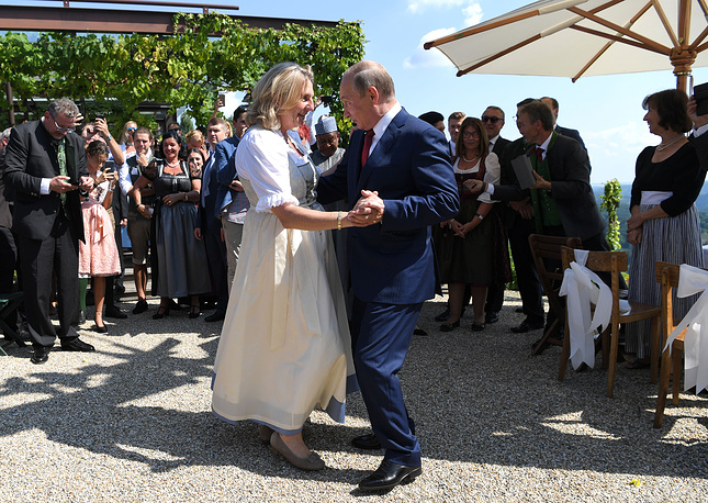 Russian President Vladimir Putin dances with Austrian Foreign Minister Karin Kneissl during her wedding to Austrian businessman Wolfgang Meilinger in Gamlitz, August 18