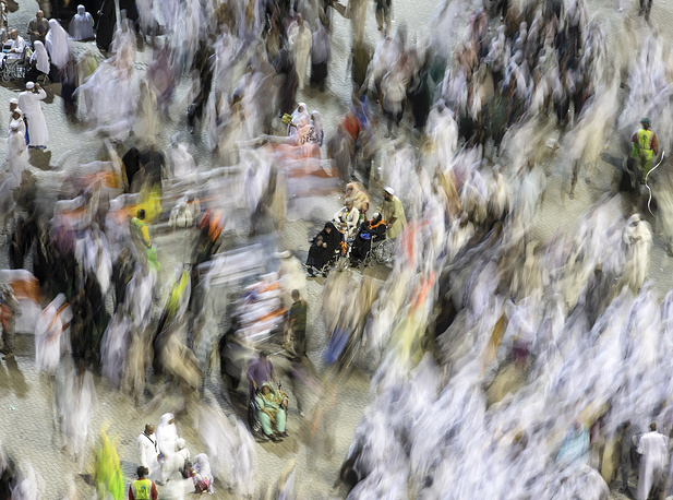 A long exposure photo showing Muslim pilgrims arriving to throw stones towards the symbolic devil represented by a Jamarat (Burning Coal) on the last day of the Muslims Hajj 2018 pilgrimage in the tent City of Mina near Mecca, August 22