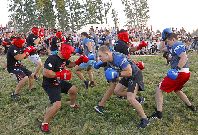 Men take part in the Russian wall-to-wall fistfight as part of the annual Atmanovskie Kulachki traditional festival in the village of Atmanov Ugol, in the Tambov Region