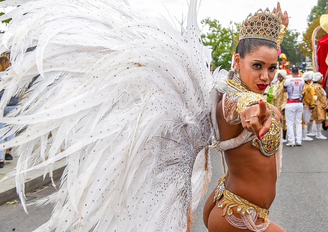 A performer dressed in a feathered costume