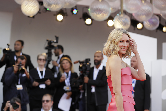 Jury member Naomi Watts poses for photographers upon arrival at the opening ceremony of the 75th edition of the Venice Film Festival