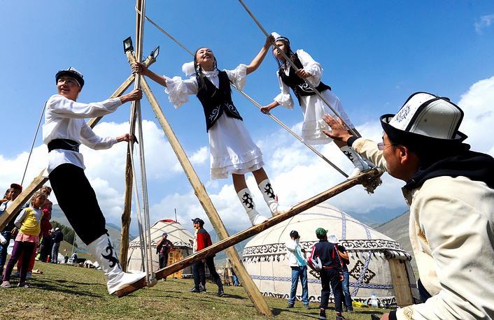 Participants enjoy an amusement ride at the 2018 World Nomad Games