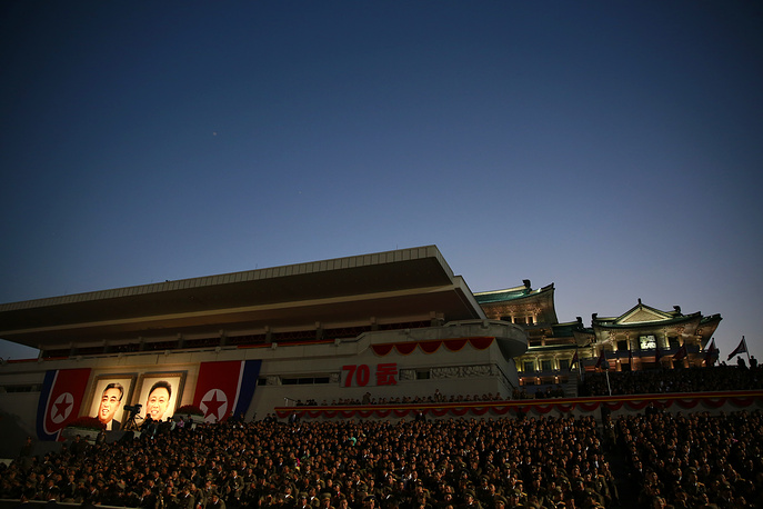 North Korean military officials watching torch light parade