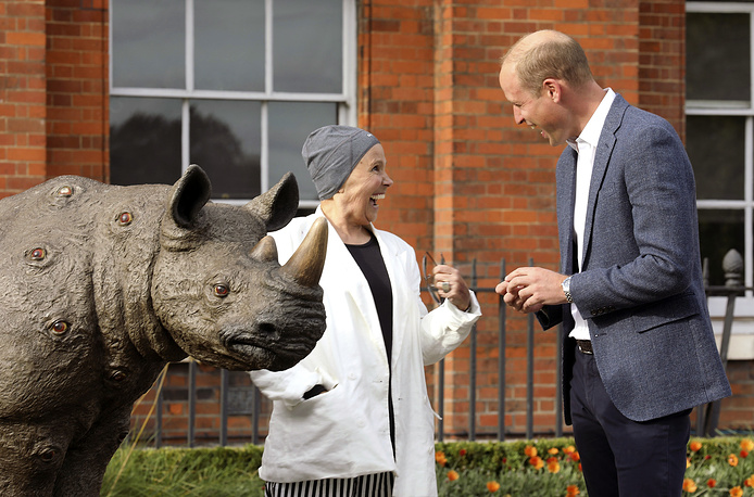 Britain's Prince William speaks with artist Nancy Fouts as he attends an event to celebrate the Tusk Rhino Trail, a London-wide art installation that celebrates the rhino and draws attention to the global poaching crisis, at Kensington Palace Gardens in London, September 10
