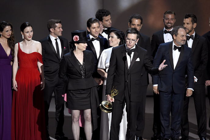"Amy Sherman-Palladino, Daniel Palladino and the cast and crew of ""The Marvelous Mrs. Maisel"" accepting the award for outstanding comedy series"