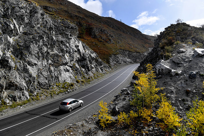 Taking the high road: lone automobile travels along Russia's Chuya Highway, or the R256