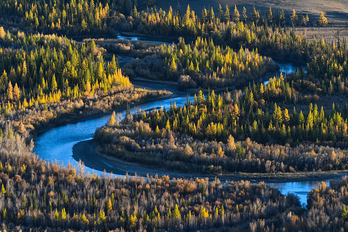 A winding river stretching across the Altai wilderness