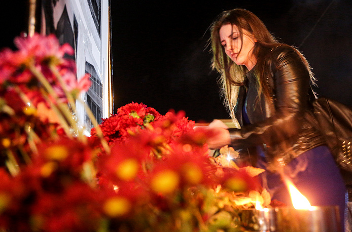 Flowers and candles left by mourners in the city of Simferopol