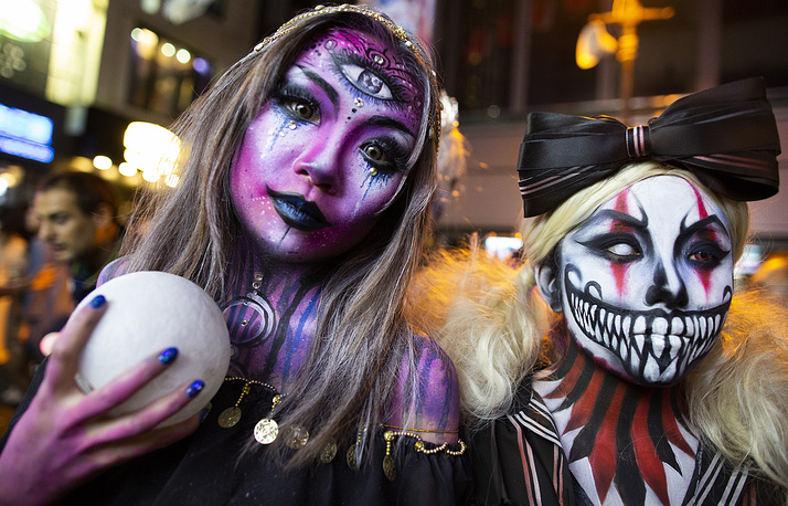 Costumed revellers attend Halloween celebrations in Lan Kwai Fong in Hong Kong