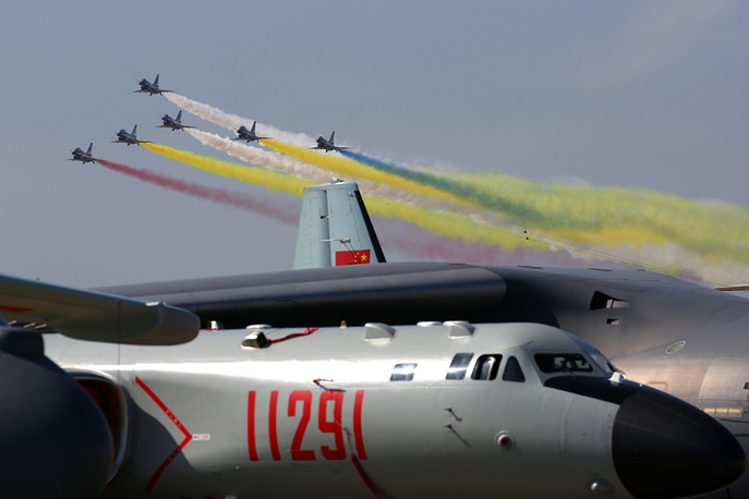 The August 1st aerobatic team piloting Chengdu J-10 fighter aircraft perform a demonstration flight