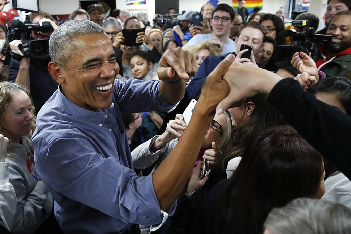 Former US President Barack Obama smiles as he greets Democratic volunteers in a surprise appearance in Fairfax Station, November 5