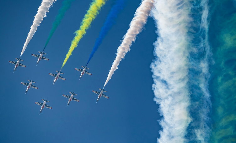 Chinese J-10 fighter jets fly in formation during a flying display on the first day of a military airshow in Zhuhai, November 6