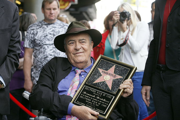 Bernardo Bertolucci holding a star plaque at a ceremony in his honor in Los Angeles, 2013