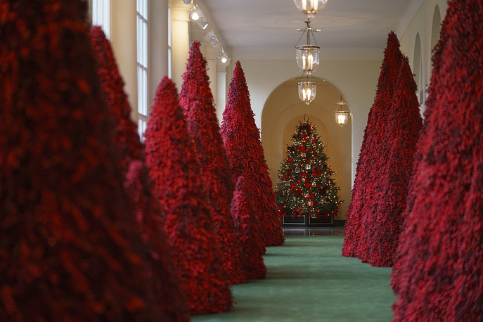 Topiary trees line the East colonnade during the 2018 Christmas Press Preview at the White House in Washington, November 26