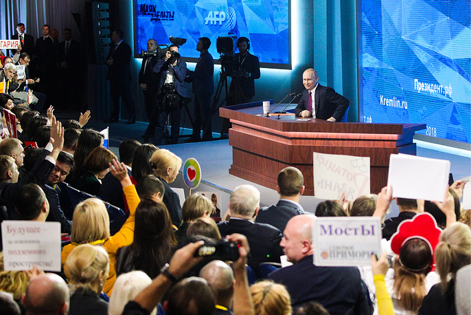 Russia's President Vladimir Putin hosts his annual end-of-year news conference at Moscow's World Trade Center, December 20