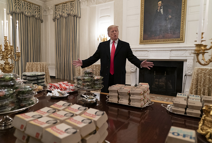 US President Donald Trump presents fast food to be served to the Clemson Tigers football team to celebrate their Championship at the White House in Washington, January 14