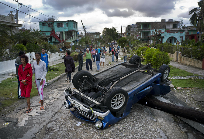 A tornado and pounding rains smashed into the eastern part of Cuba's capital overnight, toppling trees, bending power poles and flinging shards of metal roofing through the air as the storm cut a path of destruction across eastern Habana