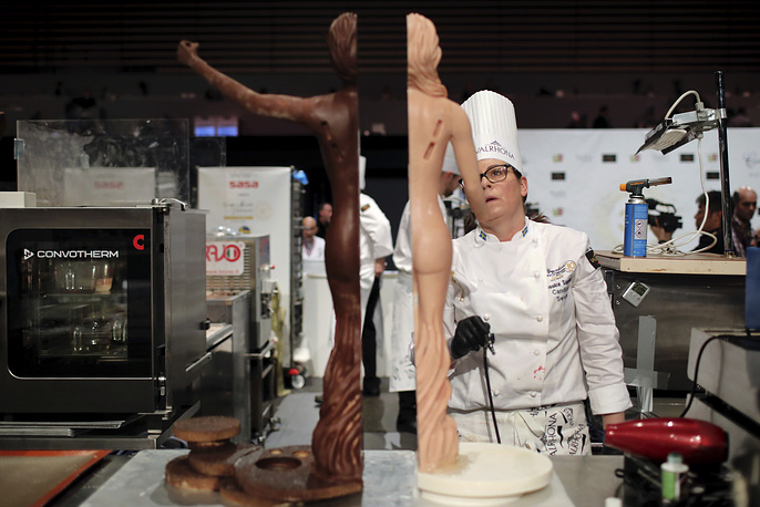 Jessica Sandberg, member of the Sweden team, prepares a dessert during the World Pastry Cup in Lyon
