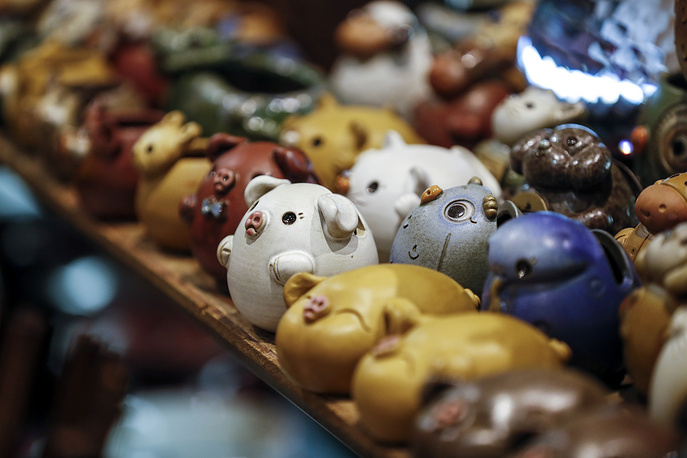 Pig figurines are displayed for sale on the eve of Chinese Lunar New Year in Taipei, Taiwan. During the Spring Festival, Chinese all over the world reunite with family members, visit friends and relatives, exchange gifts, give red envelopes with money inside to children, set off firecrackers and visit temples to pray for peace in the New Year