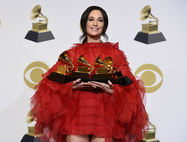 "Kacey Musgraves, winner of the awards for best country album for ""Golden Hour"", best country song for ""Space Cowboy"", best country solo performance for ""Butterflies"" and album of the year for ""Golden Hour"""